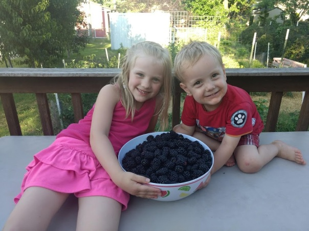 Kids with bowl of blackberries